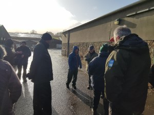 Group stands in farm yard